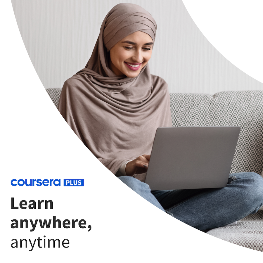 Coursera Plus learner on a laptop